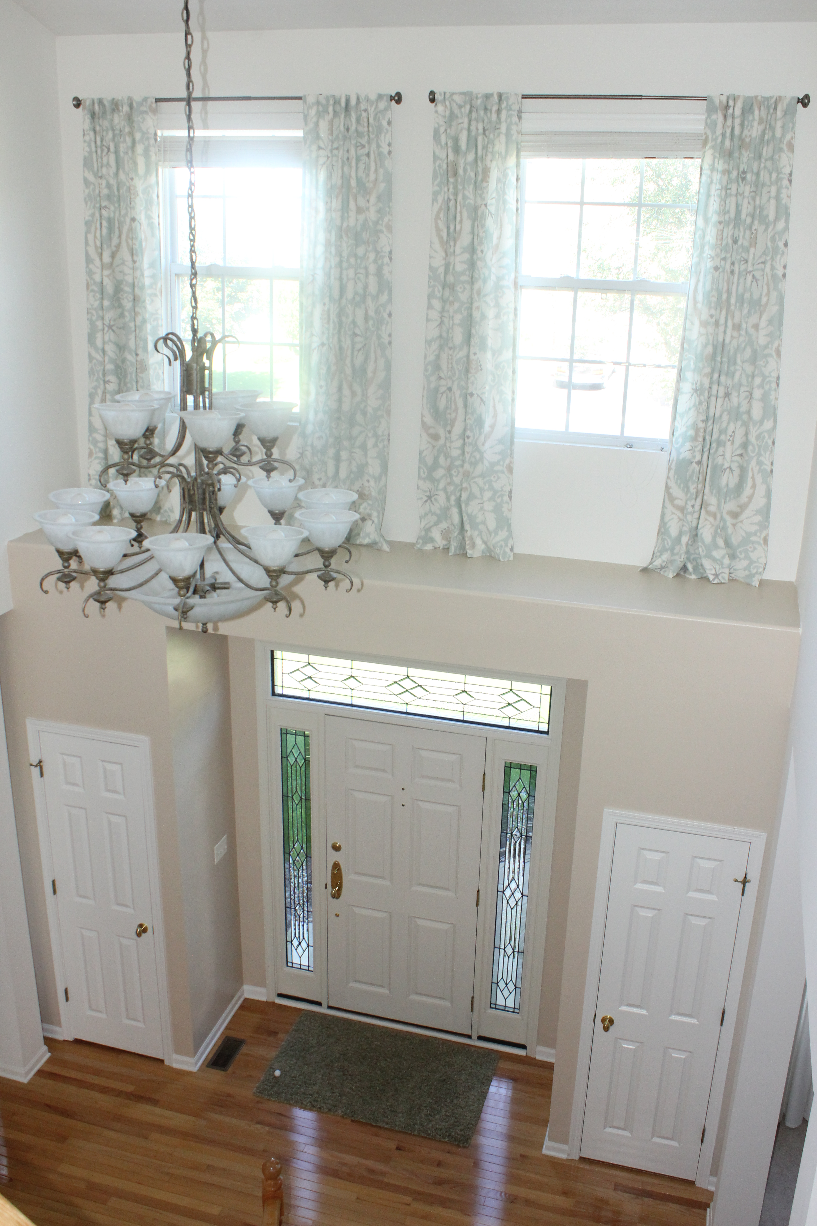 Foyer Window Cost : The difference drapes make nesting in naperville